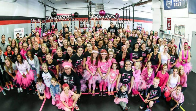 More than 100 men, women and children participated in last fall's Barbells for Boobs fundraiser at CrossFit Webster.