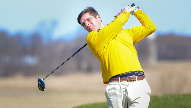Marquette's Harrison Ott hits his drive on No. 2 during the Washington County boys golf invitational.