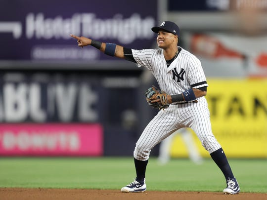 Yankees second baseman Starlin Castro reacts after he thinks a called ball should have been a strike early in the AL wild card game against the Twins at Yankee Stadium on  Tuesday, Oct. 3, 2017.