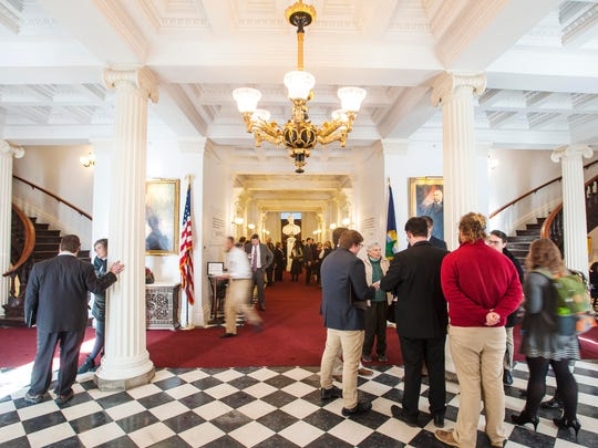 People fill the halls of the State House on the opening