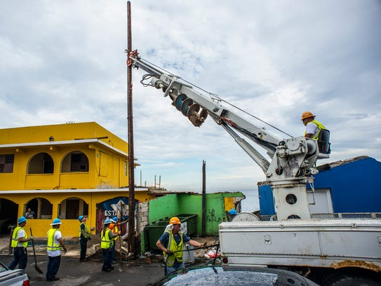 Papo Rodriguez of Haverstraw sets a utility pole in
