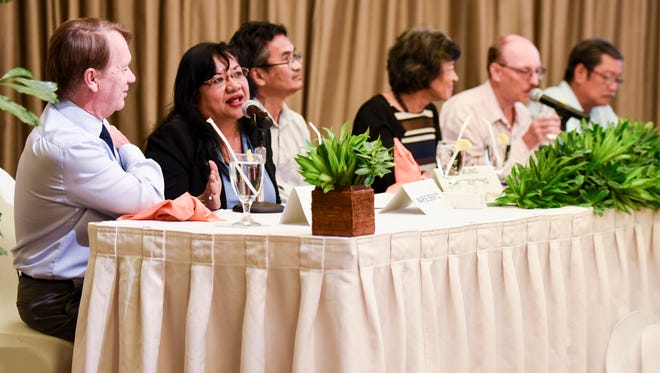 Maria Benito, Guam Department of Revenue and Taxation deputy director, replies to a question posed during a panel discussion at the Guam Women's Chamber of Commerce's 2018 Guam Tax Plan & Economic Forum at the Hilton Guam Resort & Spa in Tumon on Friday, Mar. 9, 2018.