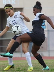 La Quinta High School's Jiana Guerrero tries to win control of the ball from a Grand Terrace High School player at La Quinta on February 16, 2017. La Quinta won 2-1.
