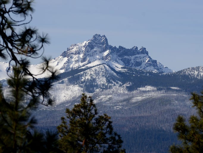 A snow-capped Three Fingered Jack is seen from highway
