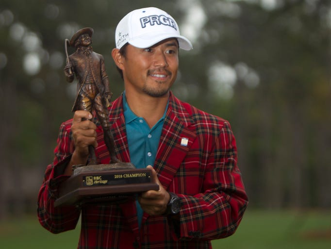 April 15: Satoshi Kadaira poses with the trophy after