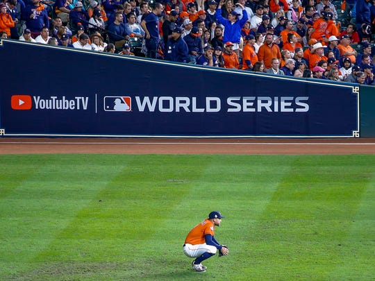 Houston Astros center fielder George Springer watches in the outfield during the ninth inning of Game 7 of the baseball World Series against the Washington Nationals Wednesday, Oct. 30, 2019, in Houston. (AP Photo/Eric Gay)