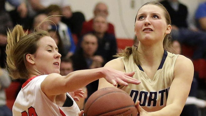 Sydney Levy of Appleton North (right) tries to get up a shot against Hailey Ruplinger of Kimberly during a Fox Valley Association game Friday in Kimberly. To see more photos from the game, go to postcrescent.com.