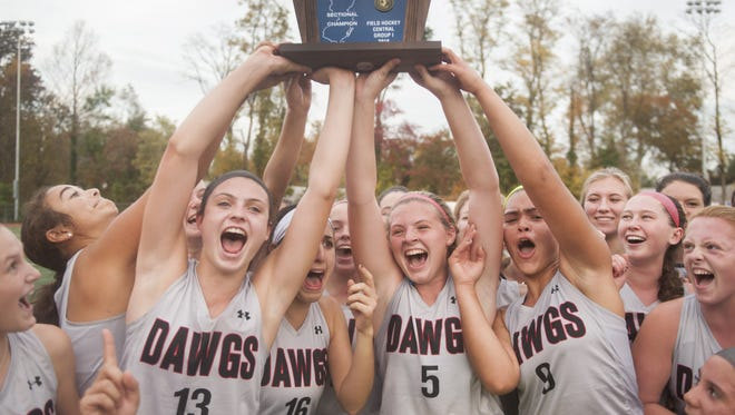 Members of the Haddonfield field hockey team hoist the sectional championship trophy after Haddonfield defeated Collingswood in the Central Jersey Group 1 final on Thursday.