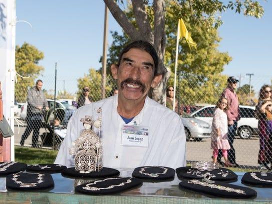 Silversmith Juan Lopez of Albuquerque shows his creations