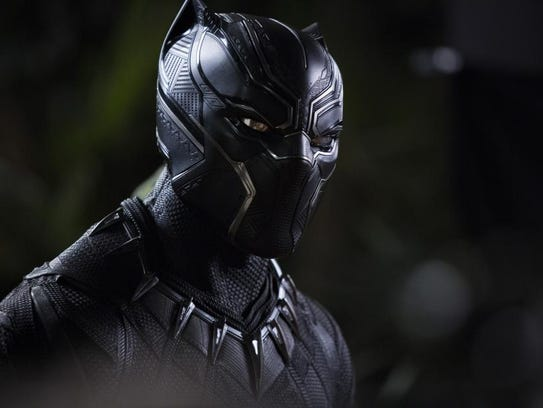 Chadwick Boseman shows off his 'Black Panther' outfit.