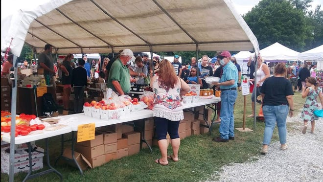 Visitors found fresh peaches and other produce at the 41st annual Leitersburg Peach Festival. ALEXIS FITZPATRICK/HAGERSTOWN HERALD-MAIL
