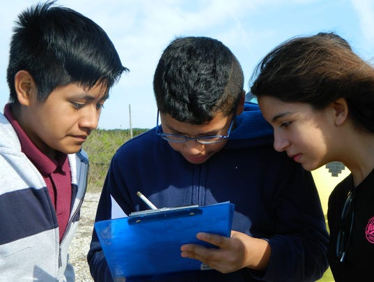 Students record water quality data.JPG