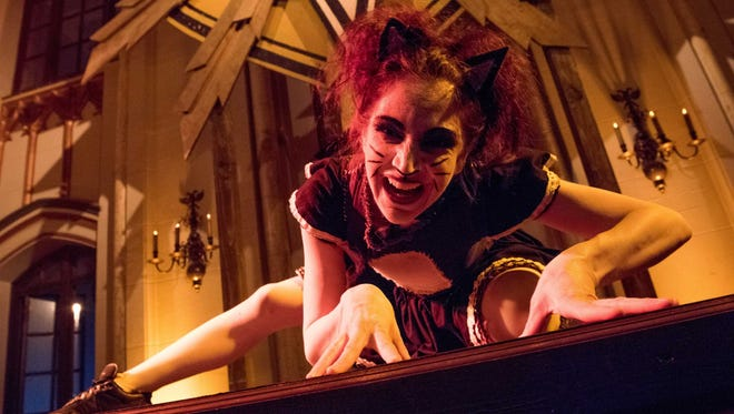 """Theatre Bizarre, the annual Halloween masquerade staged at the Detroit Masonic Temple. The event takes up seven of the building's sixteen floors. The performers include local and national music acts, burlesque dancers, suspension artists and sideshow """"freaks"""". October 14, 2017."""