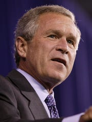 Then President George W. Bush speaks at the Pontiac Silverdome  Oct. 27, 2004.