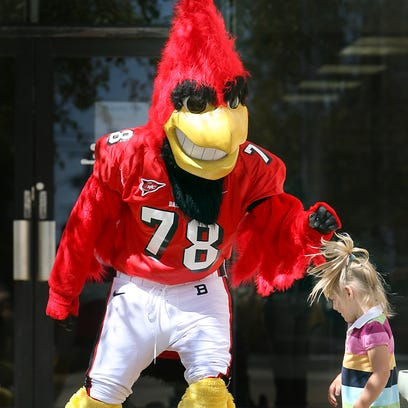 Charlie Cardinal meets a young fan at a past community