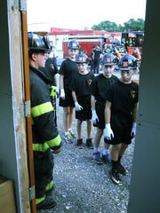 The cadets examine a building that will be burned as a demonstration for the group.