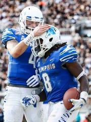 Memphis running back Darrell Henderson (right) celebrates