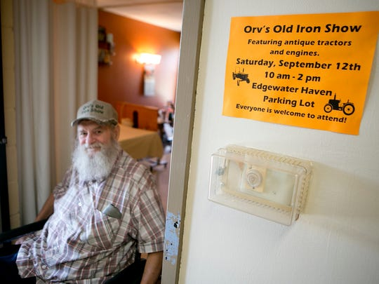 Edgewater Haven Nursing Home resident Orville Schraeder of Port Edwards exits his room where a flyer for Saturday's iron show is on display, Thursday, Sept. 10, 2015. Orv's Old Iron Show will be held in the Edgewater Haven parking lot from 10 a.m. to 2 p.m.