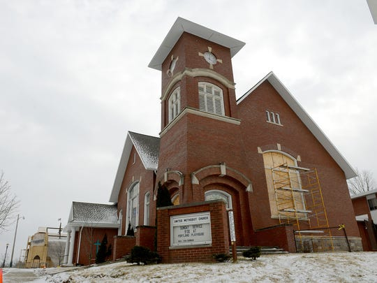 With a new roof and some of the windows still boarded up Friday, Feb. 12, 2016 the Portland United Methodist Church in Portland will hold its first service on Feb. 21 since an EF-1 tornado tore through the city in June.