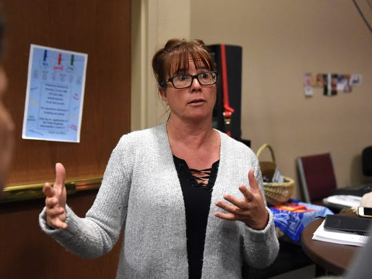 Carina Black with the Northern Nevada International Center talks to attendees of a press conference about President Trump's executive order on the refugee resettlement program on Jan. 25, 2017 at the Sparks Christian Fellowship.
