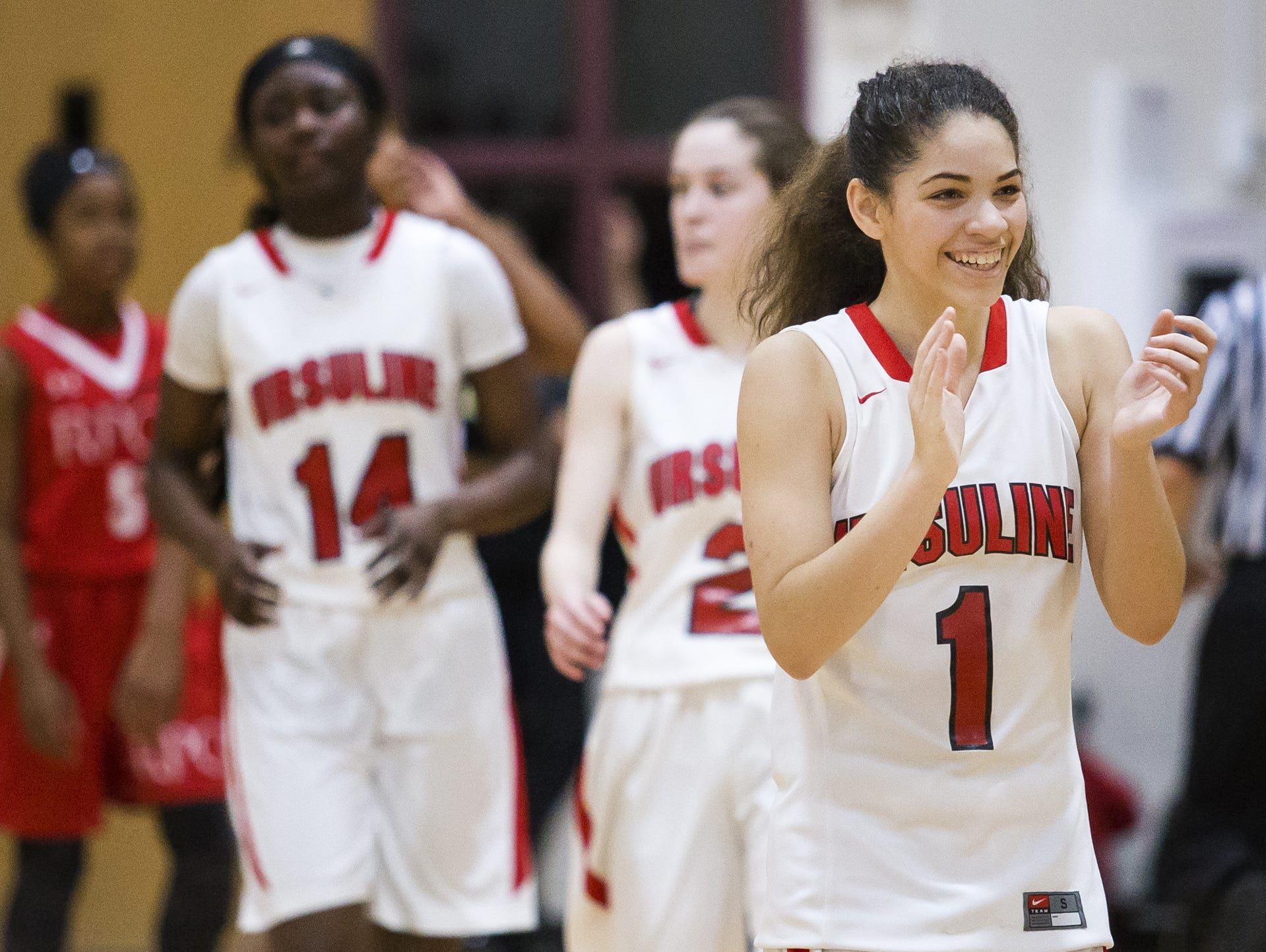 Ursuline's Alisha Lewis (1) was voted girls player of the year and heads the DSBA All-State girls basketball team released Wednesday.