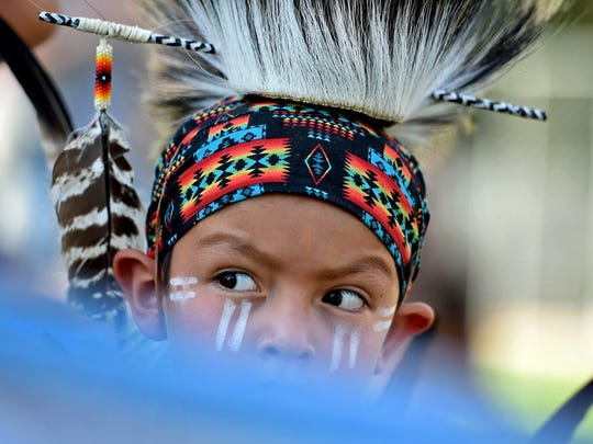 Urijah Thomas, 5, from Pyramid Lake wait to dance traditional Native American dances for the closing of Artown at Wingfield Parks on Monday July 31, 2017.