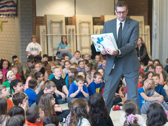 Dr. Matthew Strine, Tuscarora School District superintendent, reads a Dr. Seuss book to students at  Montgomery Elementary School, Mercersburg.