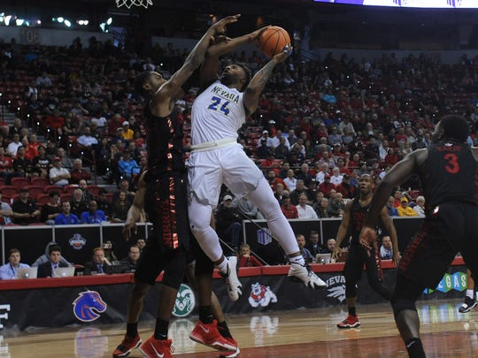 Nevada's Jordan Caroline shoots against UNLV during last season's Mountain West Tournament in Las Vegas.
