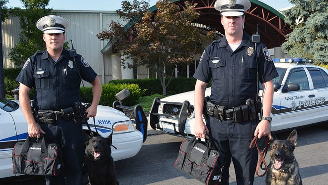 West Chester Police Department K9 dogs Blek, left, with Officer Rob Obermeyer; and Ciro, with Officer Michael Blankenship, are set to receive new, protective vests thanks to a donation by township resident Vikki Johnston.