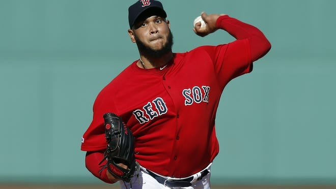 In this Sept. 29, 2019, file photo, Boston Red Sox's Eduardo Rodriguez pitches during the first inning of a baseball game against the Baltimore Orioles in Boston. Rodr‡guez has missed the entire season because of heart inflammation caused by COVID-19.