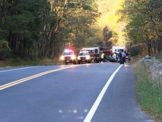 Firefighters and New York State Park Police respond to a one-car crash Tuesday, Oct. 15, 2013 on Seven Lakes Drive in Bear Mountain State Park. (James O'Rourke/The Journal News)