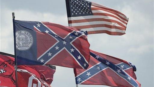 Confederate and American flags fly on top of motor homes at Daytona International Speedway during Sunday's NASCAR race.