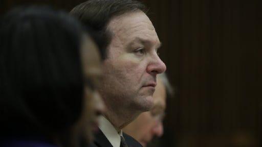 Bob Bashar listens to testimony during his trial.