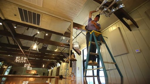 Bill Young works on hooking up a train's horn inside the Sweetwater Depot in Florence, Ala. Chris Heaton and others have worked relentlessly to bring life back into the Sweetwater district.