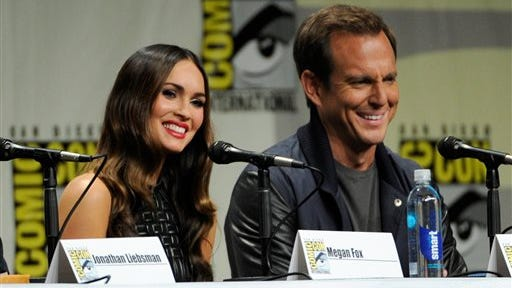 "Megan Fox, left, and Will Arnett attend the ""Paramount Pictures"" panel on Day 1 of Comic-Con International on Thursday in San Diego."