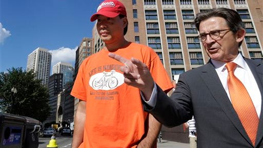 Glenn Adam Chin, left, a former supervisory pharmacist at the New England Compounding Center, walks with his attorney Paul Shaw, right, after appearing in federal court, today in Boston. The pharmacy, which custom-mixed medications in bulk, has been blamed for a 2012 outbreak of fungal meningitis that killed 64 people. Chin was charged with one count of mail fraud, but federal prosecutors said it is part of a larger criminal investigation of Chin and others.