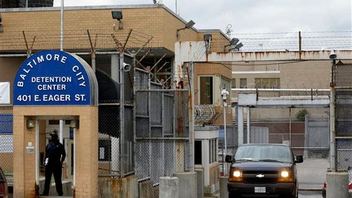 In this June 6, 2013, file photo, a prisoner transport van departs from the Baltimore City Detention Center in Baltimore.