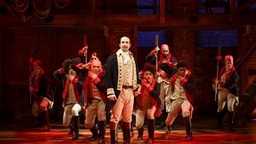 "In this image released by The Public Theater, Lin-Manuel Miranda, center, performs in the musical ""Hamilton"" at The Public Theater in New York."