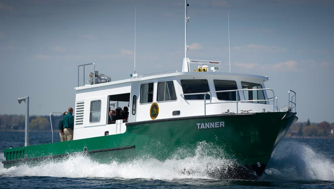 The research vessel Tanner dedicated in honor of former Fisheries Chief and former DNR Director Howard Tanner - who spearheaded the initiative to introduce salmon to the Great Lakes basin