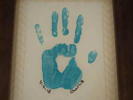 Give mom a personalized hand-print canvas with children's name and the year for Mother's Day.