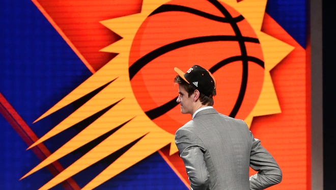 Dragan Bender walks up to the stage after being selected fourth overall by the Phoenix Suns during the NBA draft, Thursday, June 23, 2016, in New York.