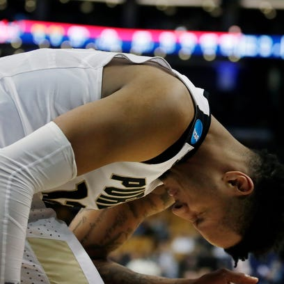 Purdue's Vincent Edwards rects after a missed shot