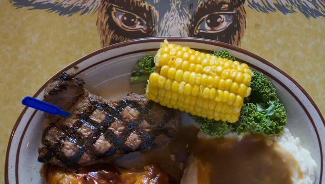 Chicken/Sirloin combo with corn and mashed potatoes dish at Bill Johnson's Big Apple restaurant.