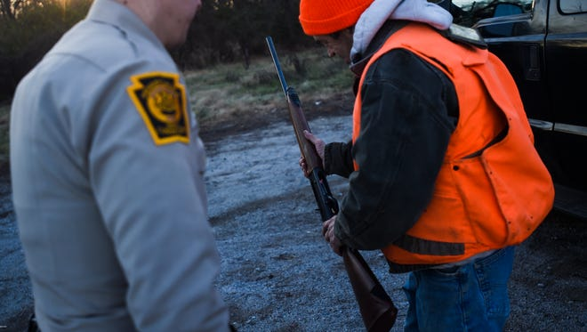 In this file photo from 2014, Wildlife Conservation Officer Steven Knickel of the Pennsylvania Game Commission checks the shotgun of hunter Stephen Gruber of Felton in the state game lands of West Manchester Township to see if the firearm meets the three shell capacity limit required by law. Shane Dunlap - The Evening Sun