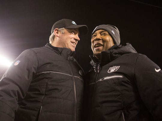 FILE -- Philadelphia Eagles head coach Doug Pederson speaks with then-Oakland running back coach Bernie Parmalee after a game at Lincoln Financial Field.