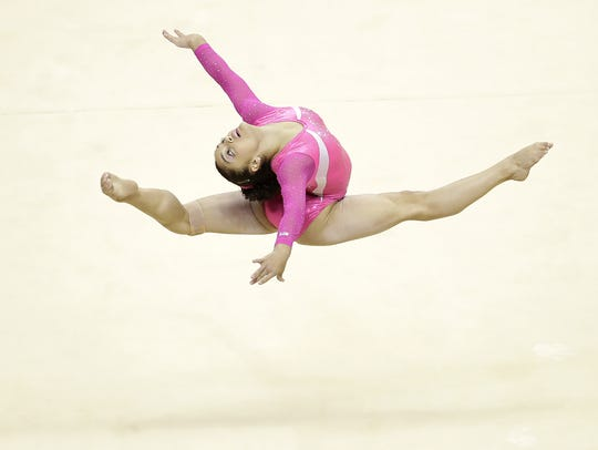 Laurie Hernandez competes on the floor exercise during