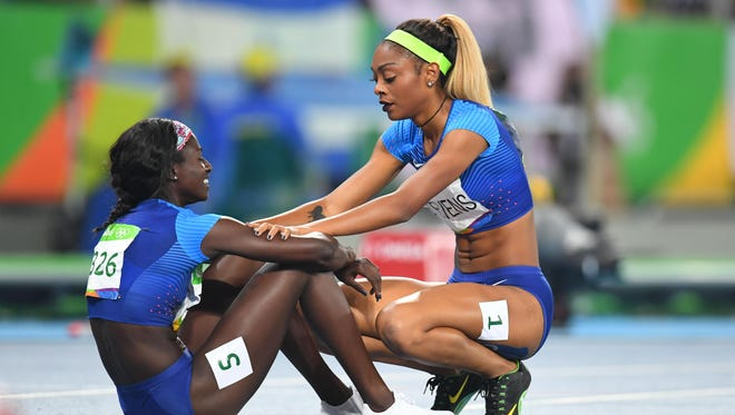 Deajah Stevens (USA) embraces Tori Bowie (USA) after the women's 200m final in the Rio 2016 Summer Olympic Games at Estadio Olimpico Joao Havelange. Christopher Hanewinckel /USA TODAY Sports