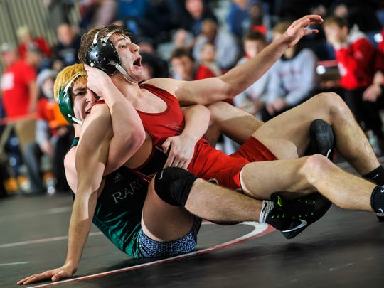 Dylan Lonnay of Raritan, left, controls Robbie Turro of High Point in their 170-pound bout in the NJSIAA finals in Toms River on Feb. 11, 2018.
