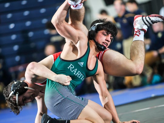 Christian Sookdeo of Raritan, right, tangles with Sawyer Fenlon of High Point in their 145-pund bout in the NJSIAA finals in Toms River on Feb. 11, 2018.
