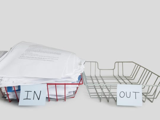 Pile of papers in office tray over white background